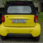Yellow smart car back