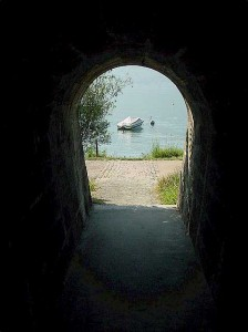 the lake seen through the foot tunnel underneath the train tracks